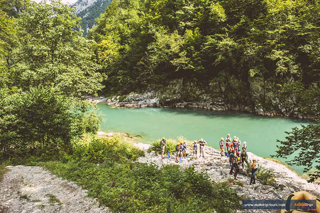 Side activities on an adventure motorcycle tour- rafting