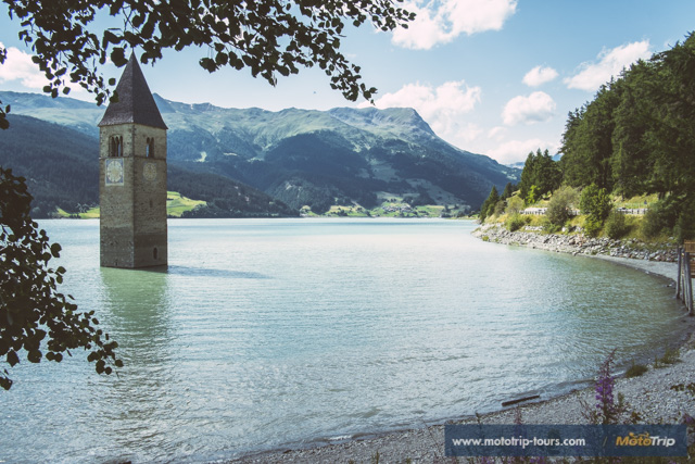 Lake Resia makes a great stop while motorcycling the Alps