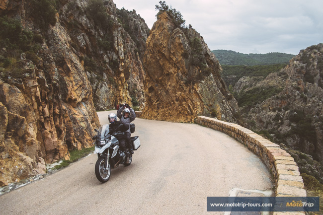 Motorcycle riders through Les Calanches, Corsica